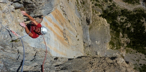 Liam coming through the roof on Ballade d'Enfer, 7b, Tete D'Aval © Oli Grounsell