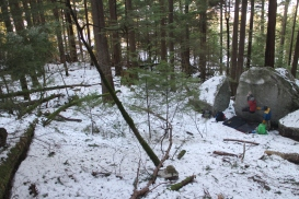 Liam bouldering in a snowy Squamish Forest