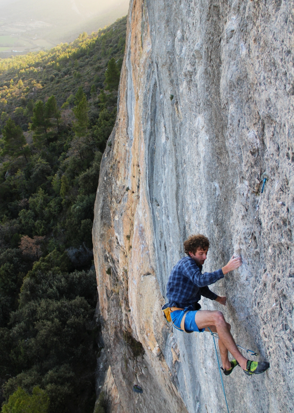 Nathan climbing China Crisis (8b+), Oliana, Spain